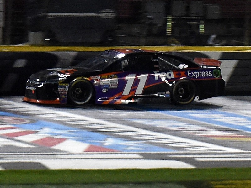 72a888c43ad816 Denny Hamlin takes the checkered flag as he crosses the finish line to win  Saturday night s NASCAR Sprint Cup Series Sprint All-Star Race at Charlotte  Motor ...