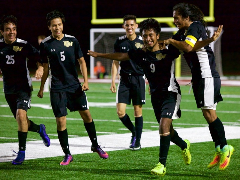 94c20e7e9 Members of the East Hall boys soccer team celebrate during a game played  earlier this season. The Vikings won 5-1 in the first round of the Class  AAA ...