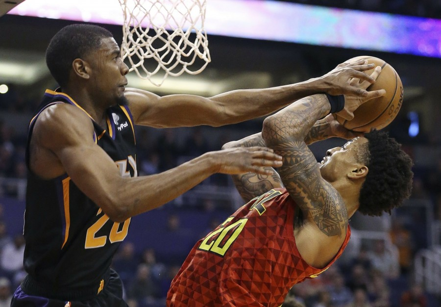 95b0b8cb7743 Atlanta Hawks forward John Collins (20) is fouled by Phoenix Suns forward Josh  Jackson